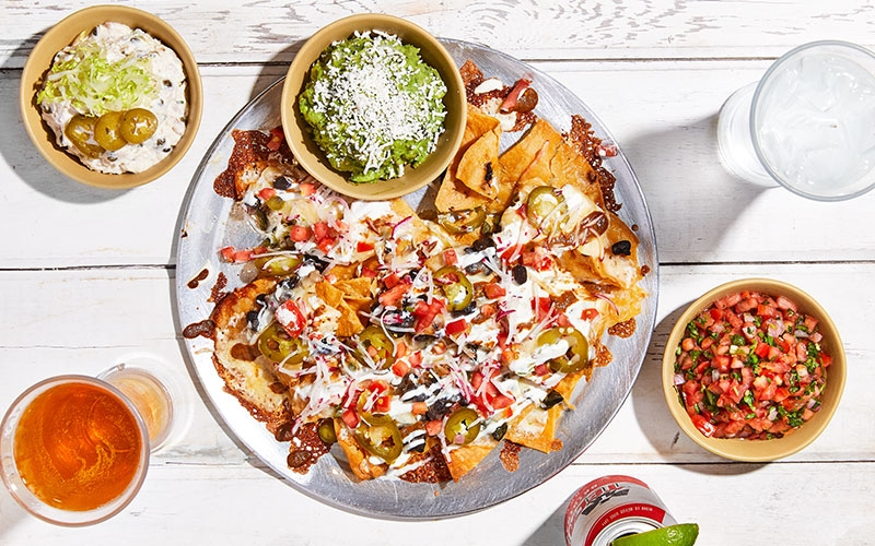 Buena Onda Mexican nachos and sides on table